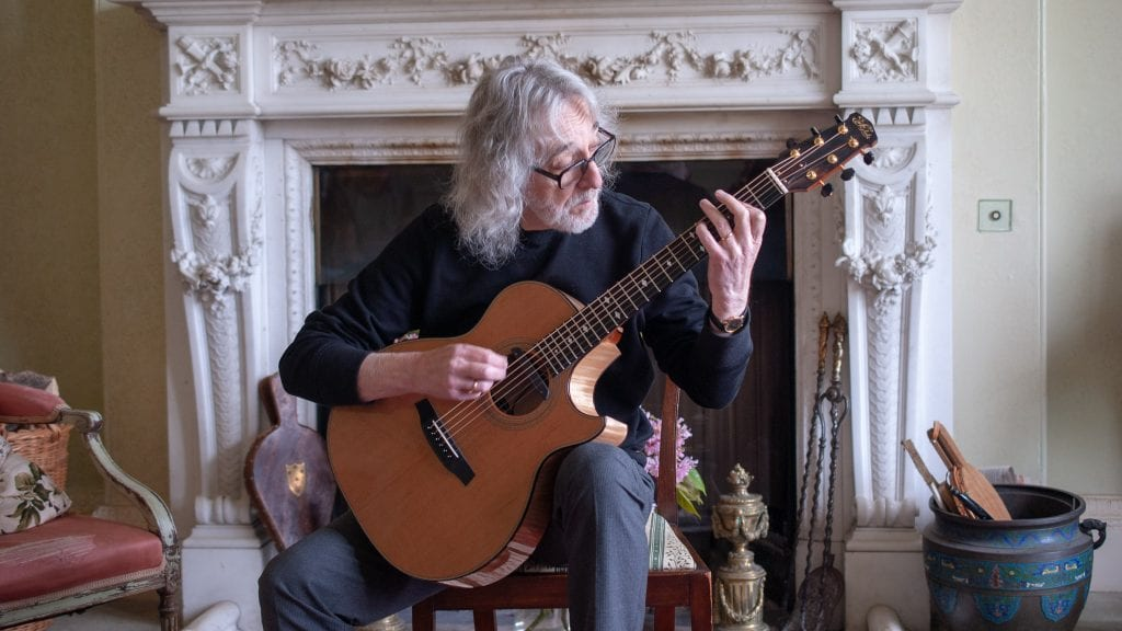 English guitar player Gordon Giltrap playing his Fylde guitar