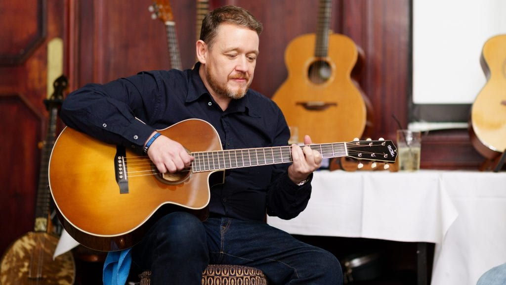 Martin Robertson playing guitar at the Halifax gathering