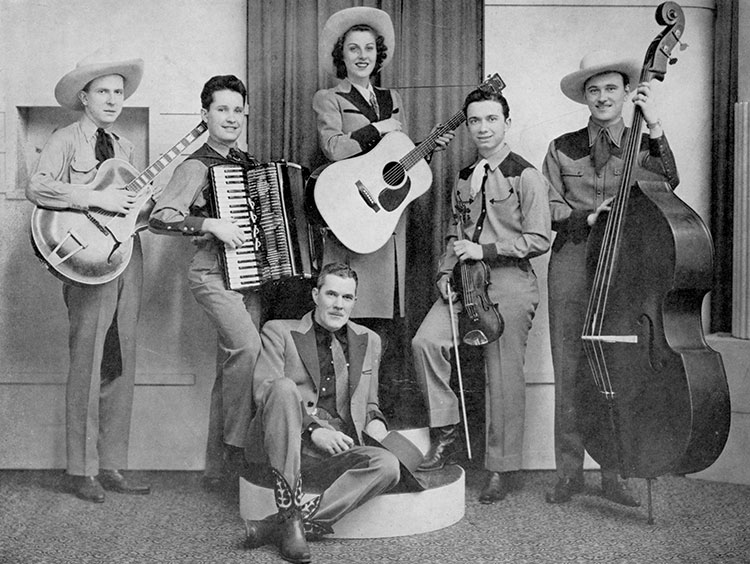 Dolly Dimples, center, with her D-18