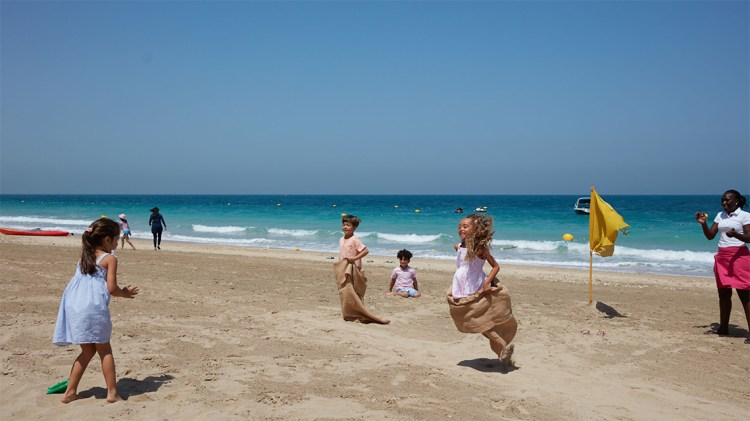 Kids playing in beach of Bluewaters Island