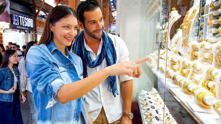 Tourist admiring gold pieces on display at the Gold Souk in Dubai