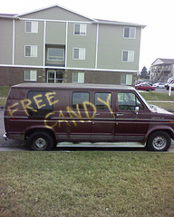 """A van with """"free candy"""" painted on its side"""