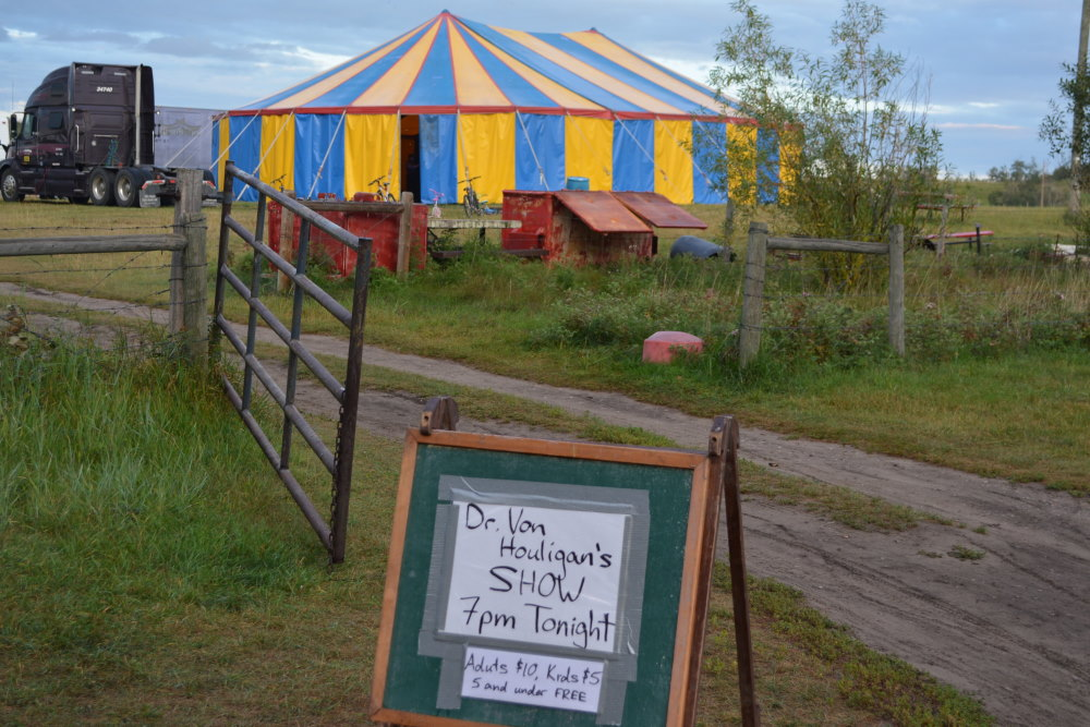 blue and yellow circus tent in field