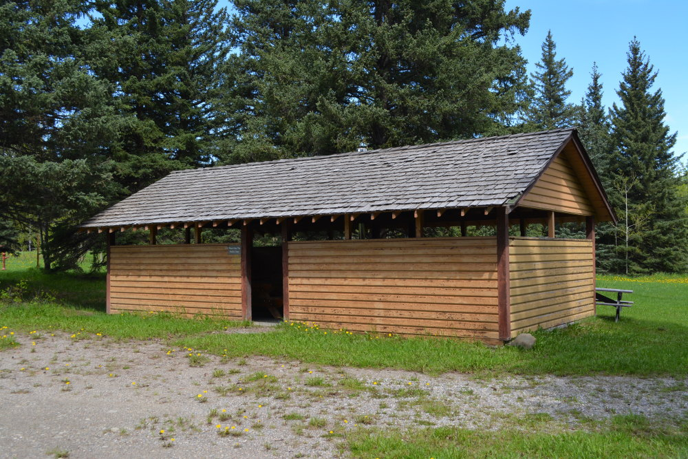 Rickety wooden cookhouse shelter