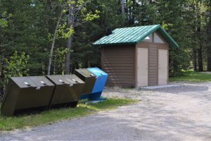 Pit toilets and bear-proof garbage containers