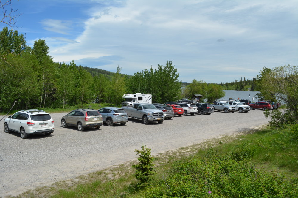 gravel parking lot filled with vehicles