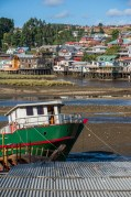 View of the Palafitos in Castro at low tide.