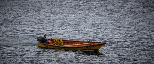 Local fisherman meeting the ferry to take passengers ashore.