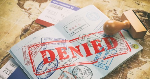 69559746 - passport with denied visa stamp on the map of the world and airline boarding pass tickets..travel concept. 3d illustration