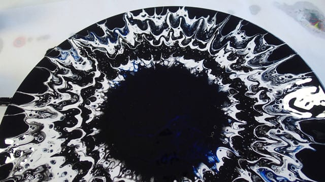 How to create simple spin art abstract paintings with acrylic pouring, and a turntable. Make stunning paintings that look like an eye.
