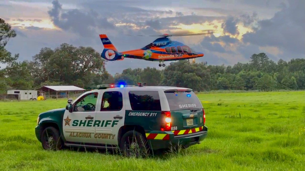 Sheriff's Office Patrol Vehicle and ShandsCair helicopter