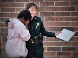Sheriff Darnell congratulates a young man who turned a gun in to his School Resource Deputy