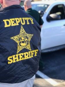 Deputy Sheriff in a raid jacket