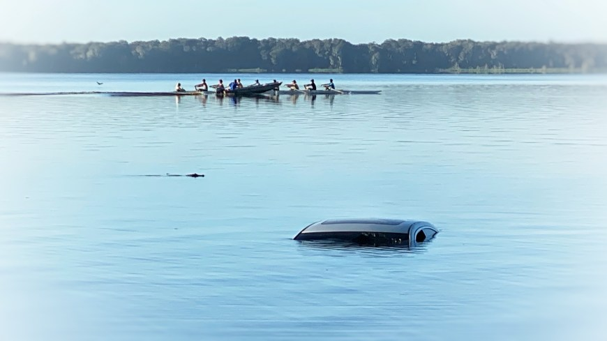 Stolen vehicle in Newnan's Lake with Rowing Team in background