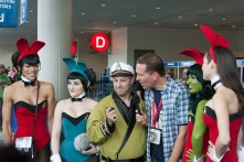 Captain Kirk discusses his travels while several bunny-clad Enterprise girls watch on.