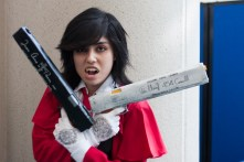 A cosplayer bares her teeth as 'Helsing's' Alucard.