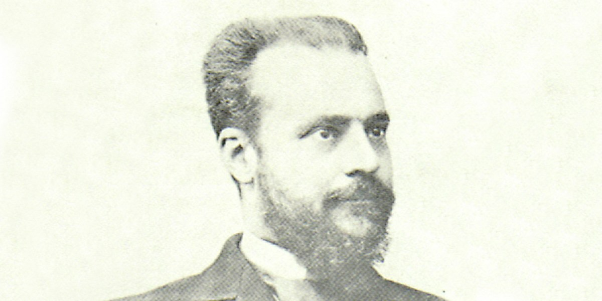 Image of Vilfredo Pareto. It is a black and white image. He has a fantastic beard and bushy eye brows.