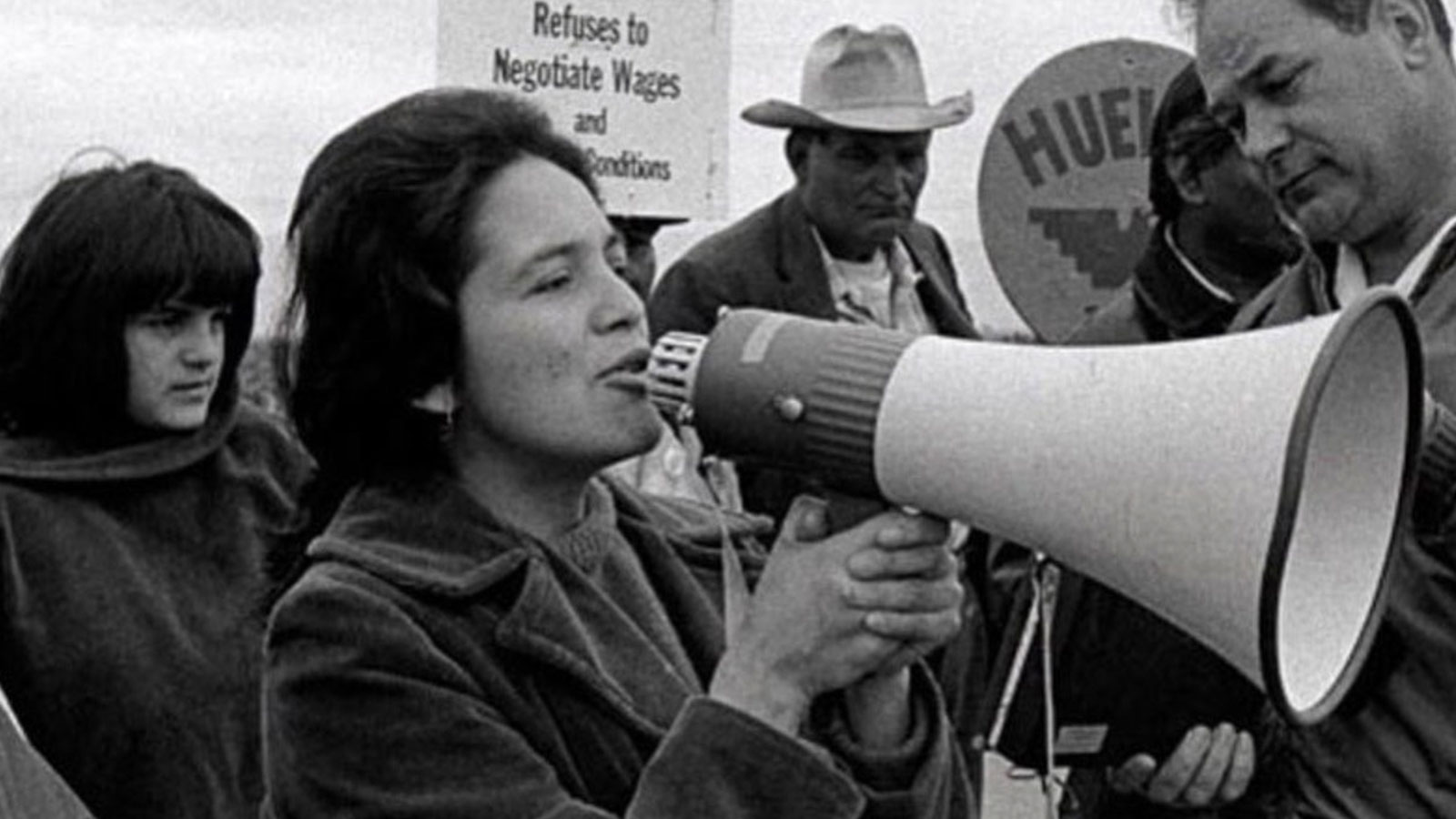 Woman called Dolores Huerta with a big fudge off mega phone