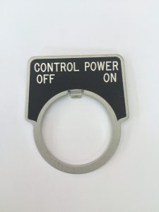 Black aluminum motor control with white letters and custom curved shape - 2.2″ x 2.2″