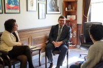 AME members Linda Kennedy and Marilyn Cohen speak with Executive Legislative Assistant Curt Kohlwes.