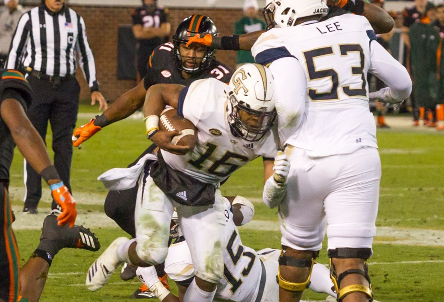 Taquan Marshall lunges forward in the game against the Miami Hurricanes at Bobby Dodd Stadium in Atlanta, GA