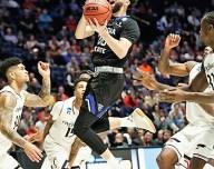 Jeff Thomas makes a move to the basket