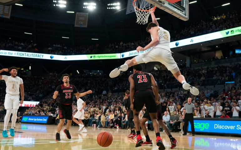 Georgia Tech Forward Evan Cole completes a high flying dunk versus the Louisville Cardinals