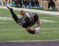Trent Richardson leaps into the endzone to score a touchdown versus the Atlanta Legends