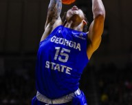 Marcus Simonds looses the ball on the way to the basket