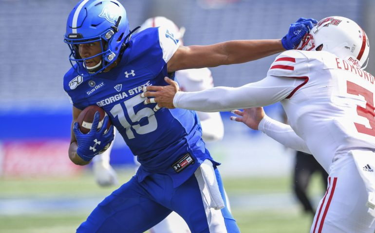 Dan Ellington breaks away from a defender during football action at Georgia State