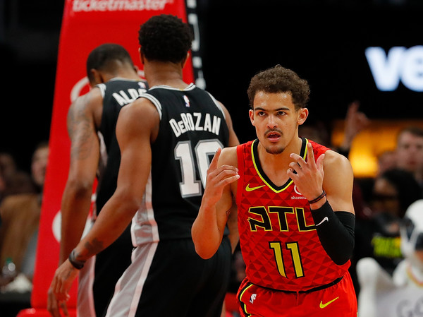 Trae Young reacts to game action