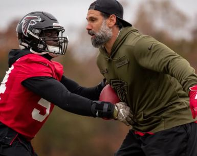 Defensive Signal Caller Jeff Ulbrich teaching technique at Falcons practice