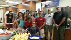 Chirag and Sean (front and center; fourth and fifth from the right, respectively) volunteering at RMDH.
