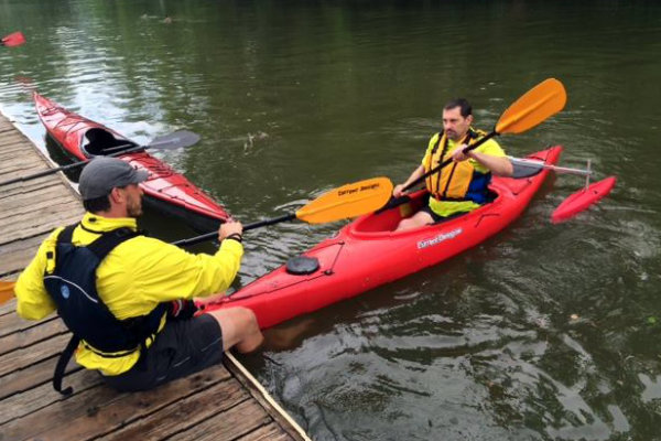 larry gioia of dynamic paddlers teaches kayaking to a client in pittsburgh pennsylvania