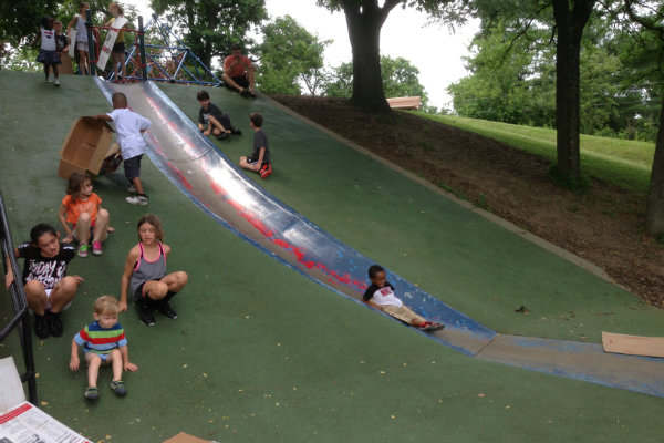 people enjoy the blue slide at frick park in pittsburgh pennsylvania