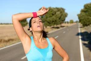 bigstock-Tired-Woman-Sweating-After-Run-52155052-1