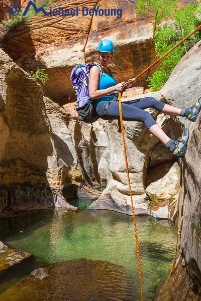 Young female hiker on the last rappel in the Subway hike (Left Fork of North Creek) in Zion National Park