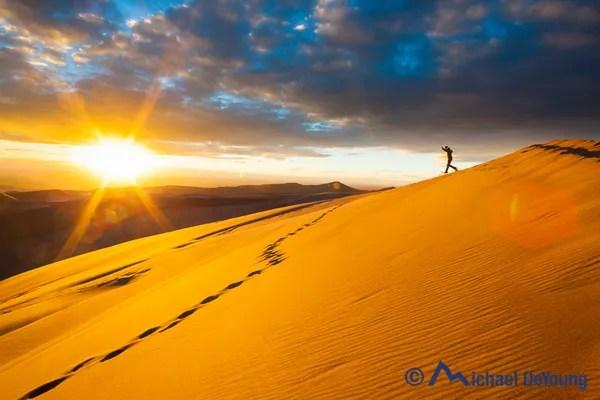 Running down sand dunes, Great Sand Dunes National Park, Colorado