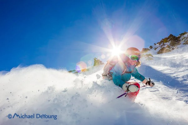 Skier carving a hard left turn on Main Street off Kachina Peak, Taos Ski Valley, New Mexico