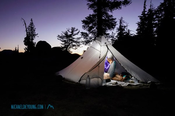 Camp in the Carson Iceberg Wilderness.  Lauri blowing up a Sea to Summit pillow.  We got used to going to bed between 7-7:30pm.  This was one of our warmest nights on the trail camped at about 9000 feet.