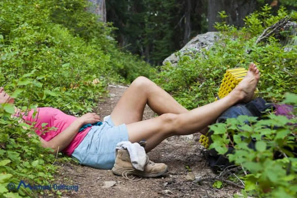 Image of female hiker resting sore feet from a 11 mile day hike along Pacific Crest Trail near Holman Pass, Pasayten Wilderness, North Cascades, Washington - Michael_DeYoung_MD120908VWA_HB34