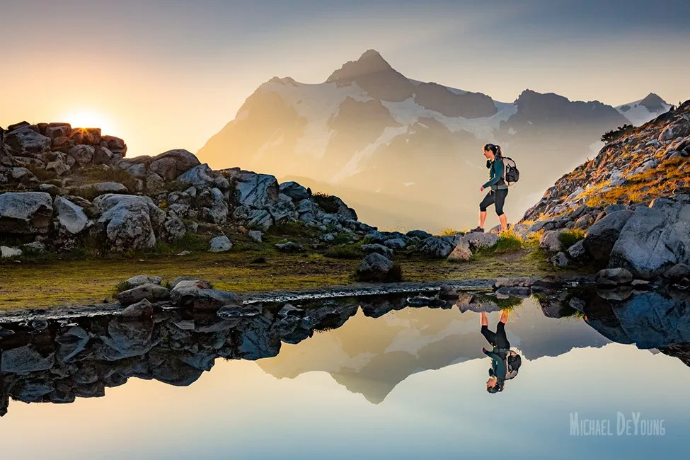 North Cascades Adventure - Hiker below Mt. Shuksan, Washington by Michael DeYoung