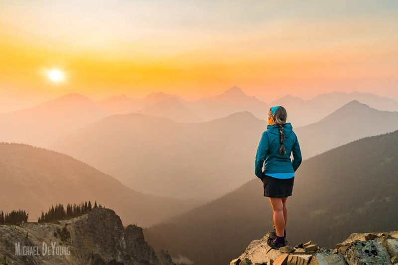 Pacific Crest Trail Adventure - Hiker watching smokey sunset by Michael DeYoung