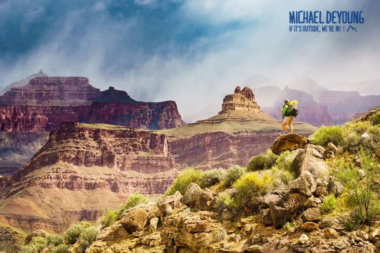 Hiker taking in the views along the Royal Arch Loop on a cool, cloudy day. Grand Canyon National Park