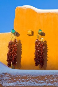 Chile ristras hanging from adobe wall