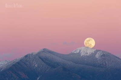 Moon rise over the mountains in Taos
