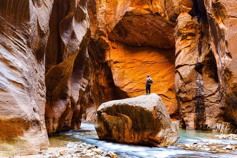 Hiker on Floating Rock in the Narrows. Photo © Michael DeYoung