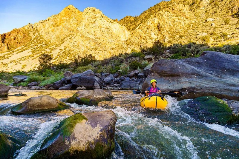Pack rafting through Big Rock Rapid on the Rio Grande near Taos, New Mexico. Photo © Michael DeYoung