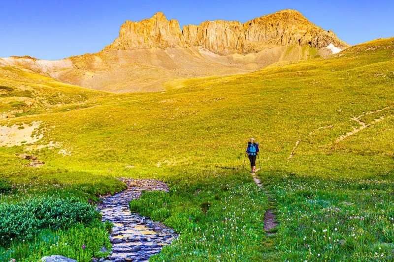 Hiker on the Colorado Trail - Continental Divide Trail by Rio Grande Creek. Photo © Michael DeYoung