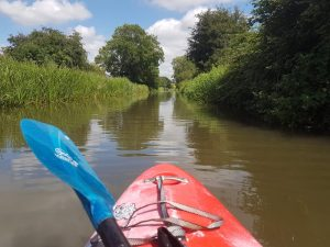 Kayaker on quiet river